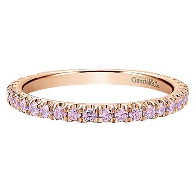This 14k rose gold eternity stackable ring features pink stones.