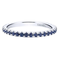 Round sapphires assemble along 14k white gold in this stunningly simple and elegant stackable ring.