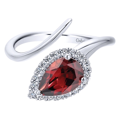 Beautiful 14k white gold served as the canvas for a single garnet with a diamond halo to surround the fiery red garnet in glamor.