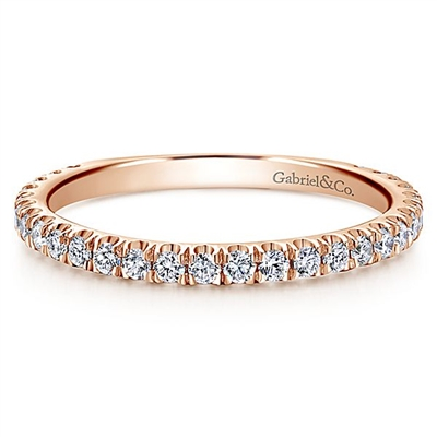 This 14k rose gold diamond stackable ring features a delicate row of shimmering diamonds that wrap around your finger.