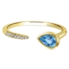 This swiss blue topaz ring features an open design with gorgeous diamonds laid over 14k yellow gold.