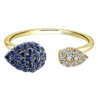 This glowing sapphire and diamond ring features bright blue sapphires and shimmering white diamonds in 14k yellow gold!