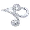 14k white gold provides the base over which round brilliant diamonds are set in this diamond fashion ring.