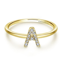 Beautiful and sleek, 14k gold and diamonds weave together to create this stackable diamond initial ring.
