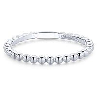This 14k white gold stackable ring features delicates beads.