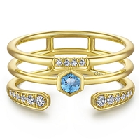 This 14k yellow gold ring is stacked with blue topaz and diamonds.