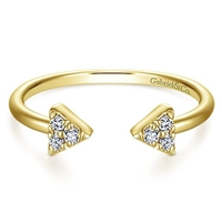 This 14k yellow gold diamond triangle stackable ring features diamond accents.