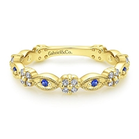 This 14k yellow gold sapphire and diamond ring is a stackable style.