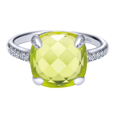 A nearly 6 carat lemon quartz stone sits in the center on a 14k white gold diamond accented band in this remade classic.