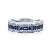 This spectacular sapphire and diamond ring features nearly one quarter carats of diamond splendor in 14k white gold.