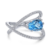 A 14k white gold diamond band with swiss blue topaz.