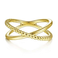 This beaded and smooth 14k yellow gold stackable ring features a modern x shape.