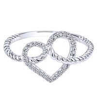 Brilliant round diamonds form a center heart in this braided and fun 14k white gold heart ring.