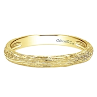 14k yellow gold with a nice textured look to give this stackable ring some excitement
