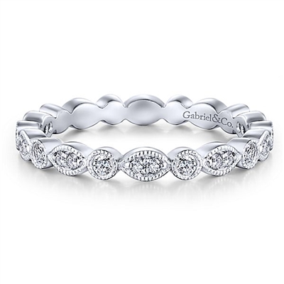 This 14k white gold stackable ring contains nearly one third carats of round brilliant diamonds.