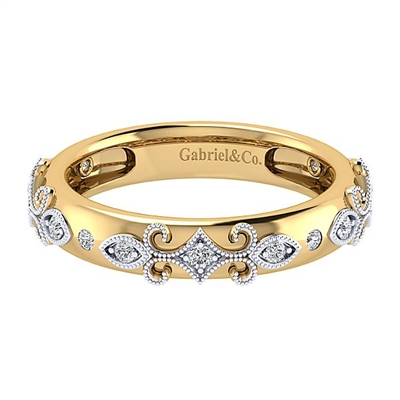 This ornate 14k yellow gold ring features 14k white gold decorative diamonds.
