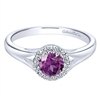 A gorgeous purple amethyst sits neatly in a halo of high quality round diamonds in this 14k white gold gemstone and diamond ring.
