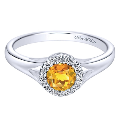 This 14k white gold citrine and diamond ring features round diamond accents in a halo, all in a petite and stylish design.