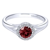 A gorgeous center garnet is gently surrounded by diamond shine in this garnet and diamond halo ring in 14k white gold.