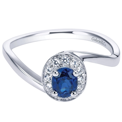 14k white gold with a sapphire and round diamonds in a halo in this gemstone fashion ring.
