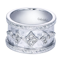 This gorgeous sterling silver wide diamond band features 0.19 carats of round brilliant diamond shine in a wide band.
