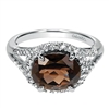 A 14k white gold diamond ring with one third carats of diamonds with a center smoky quartz.