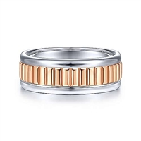 This 14k rose and white gold men's wedding band is 8mm wide and features a ridged center section.