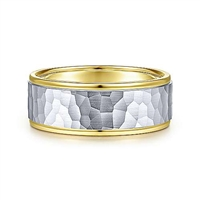 This hammered wedding band is featured in 14k yellow and white gold and is 6mm wide.