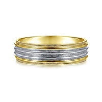 This 14k yellow and white gold men's wedding band features a milgrain channel and is 6 mm wide.