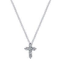 Six round brilliant diamonds sparkle in this 14k white gold prong set diamond cross with a white gold link necklace.