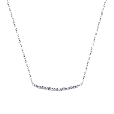 This curved diamond bar necklace features 0.20 carats of diamonds gently curving with 14k white gold.