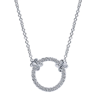 Beautiful 14k white gold serves as the setting for diamond accents in this circle of life style diamond necklace.