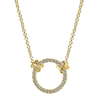 A circle of life studded with delicate diamonds all set in 14k yellow gold, grab yours today!