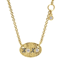 This simple xo necklace in 14k yellow gold is a cute accessory to any wardrobe, in 14k yellow gold.
