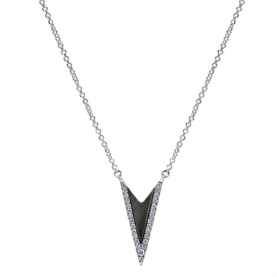 This funky black mother of pearl and round diamond necklace has plenty of attitude to go along with its sparkle,m featured in 14k white gold.