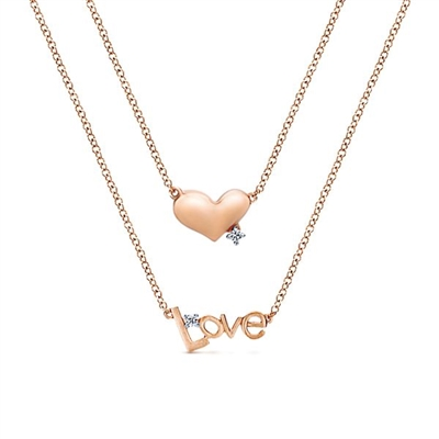 This 14k rose gold heart and love necklace features diamond accents.