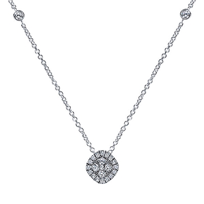 A beautiful diamond cluster featuring nearly one third carats of shimmer is attached to a 14k white gold link chain with diamond accent tags.