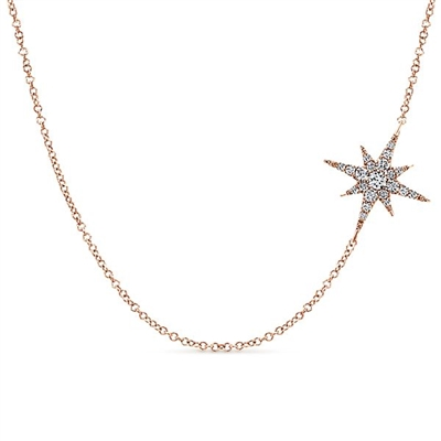 A star pendant hangs from 14k rose gold in this shimmering diamond necklace.