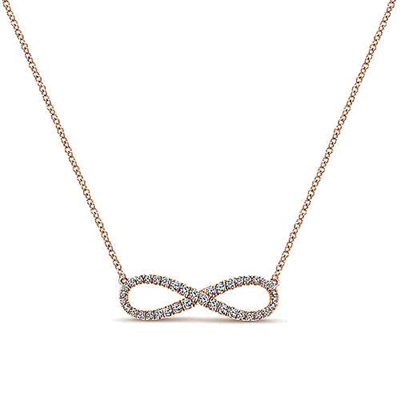 A 14k rose gold diamond infinity necklace with 0.42 carats of round brilliant diamonds.