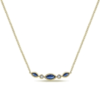 14k yellow gold serves as the canvas for this sapphire and diamond bar necklace with marquise sapphires and round diamond accents.