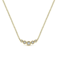 0.10 carats of round brilliant diamonds in a bar and bezel setting necklace.