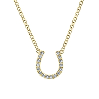 This diamond horseshoe necklace features shimmering diamond accents in the familiar and comforting equestrian symbol done in 14k yellow gold.