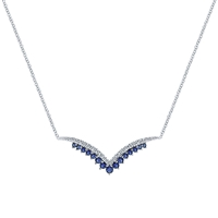 This sapphire and diamond necklace features an intricate design and a classic style in 14k white gold.