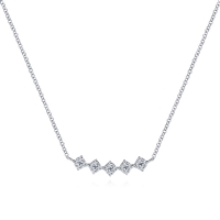 Nearly one quarter carats of diamonds coalesce in this 14k white gold diamond necklace.