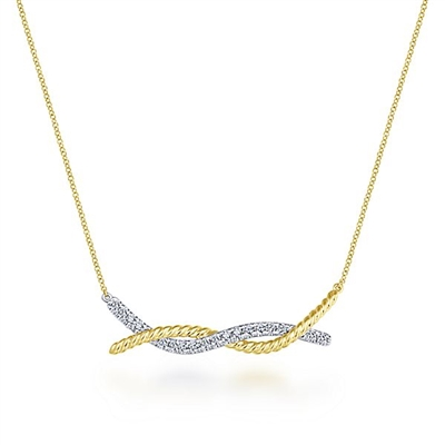This twist bar necklace is in 14k gold and features diamonds.