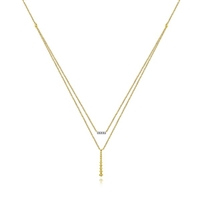 Two layered necklaces in one 14k yellow diamond bar necklace.