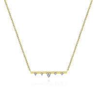 Diamonds shine in this 14k yellow gold bar necklace.