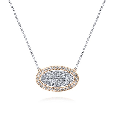 This 14k white and rose gold diamond necklace features 1 carat of diamonds.