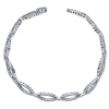 This stylish diamond tennis bracelet boasts nearly one and a quarter carats of round diamonds in oval sections spread throughout this opulent arm piece.