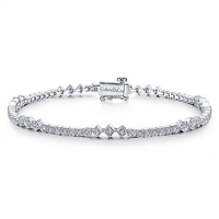 A 14k white gold diamond tennis bracelet featuring round brilliant diamonds in a vintage setting.
